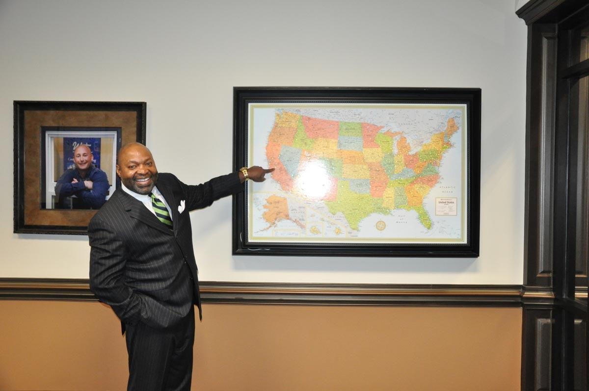 Window World franchisee Greg Deathridge points to the location of his newest store