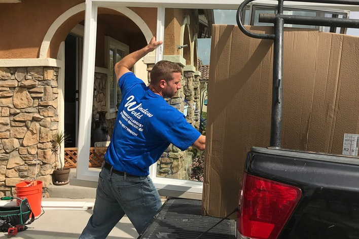 Window World installer removing products from truck
