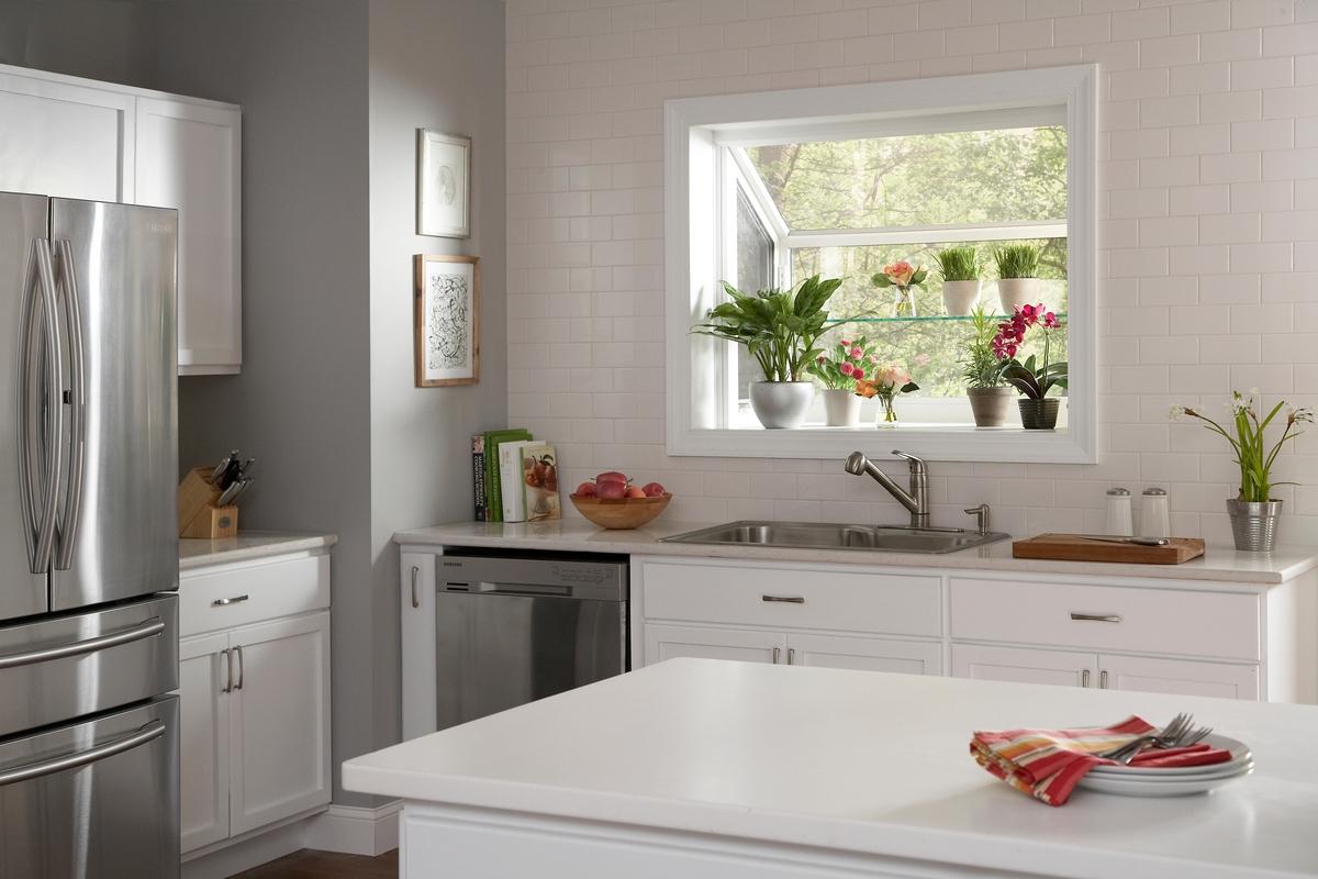 A garden window bringing light into the kitchen