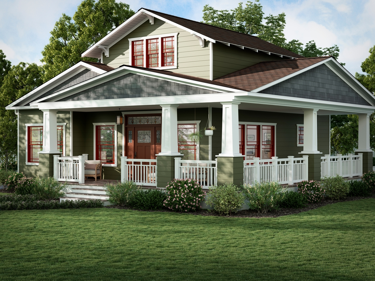A craftsman style house with green siding and red windows