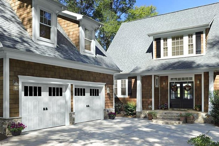 White garage doors on a tan home