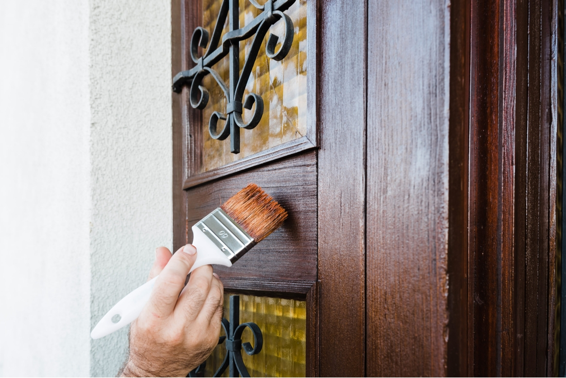 Person painting front door