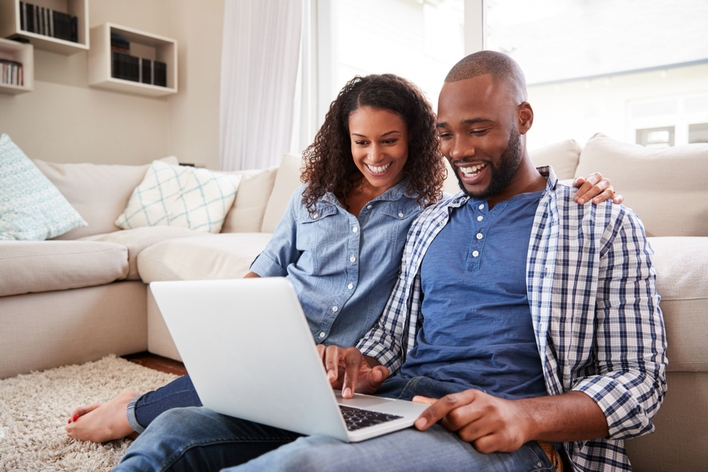 Couple planning a home remodel on a computer together