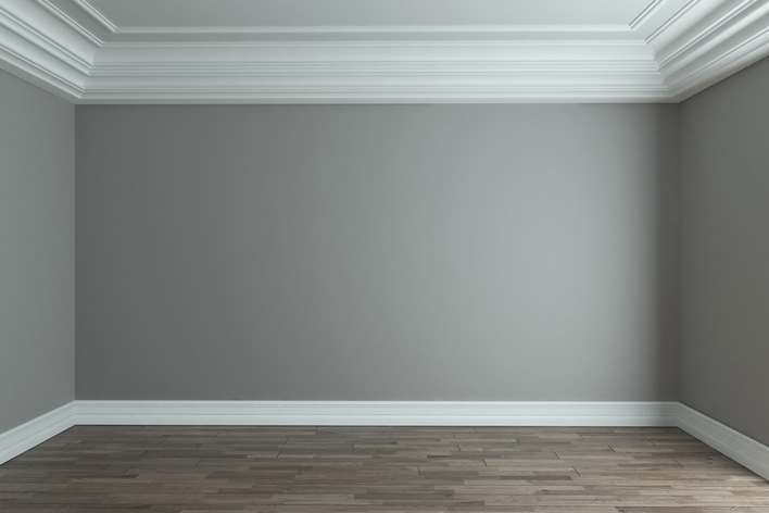 An empty room with grey walls