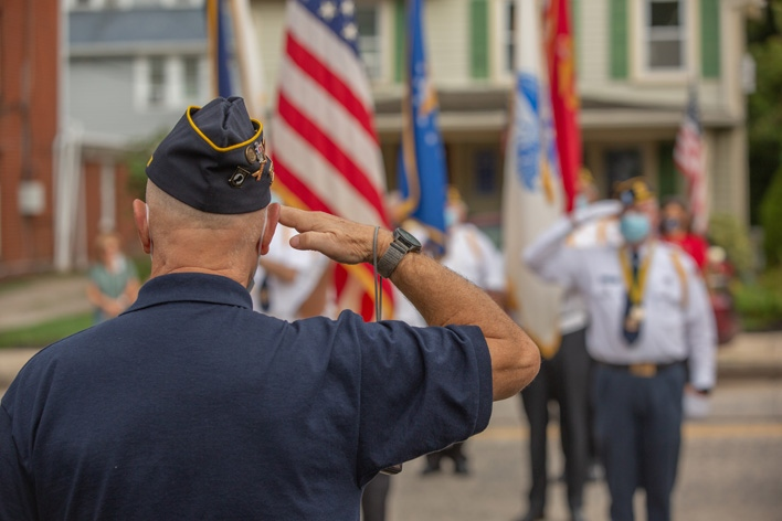 A veteran salutes the American flag