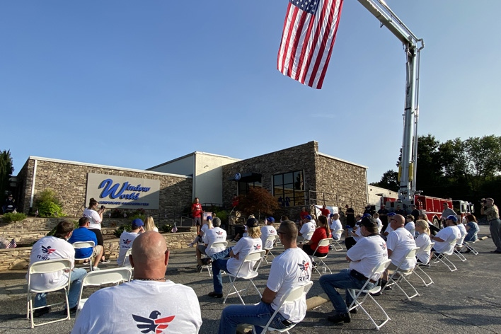 Employees gather at the corporate office on 9/11